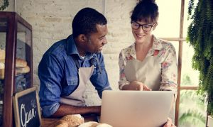 Two people looking at laptop